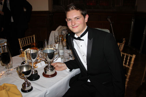 Andrew Rennie with Fives Trophies